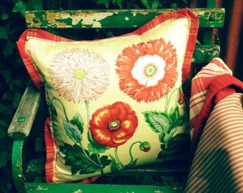Spring botanical poppy motif pillow cover in pale yellow,emerald and Raspberry tones