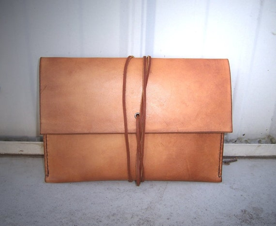 IPAD mini Leather Sleeve in Full Grain Veg Tan Leather . Hand Made in the USA from US sourced materials.