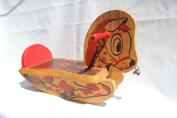 Etsy shop RagandBonesFinds offers this cute antique rocking horse