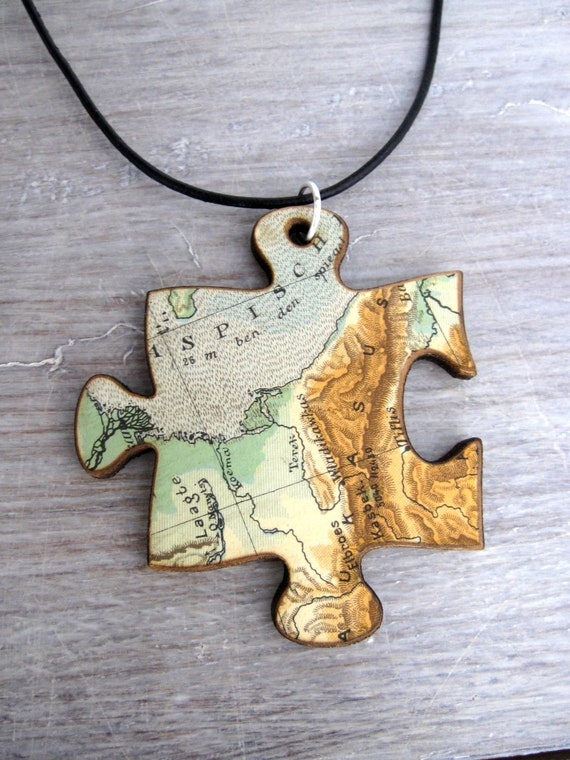 pendant / necklace - lasercut wood, covered with old map - piece of the world