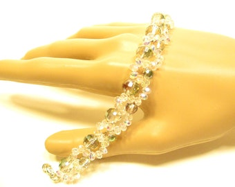 Crystal bracelet small white crystals with small and large round crystals multi color with a lobster claw clasp