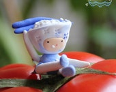 Rice President Clay Figurine Miniature in bowl of rice with chopsticks in blue & white