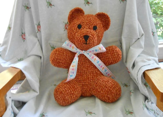Teddy Bear, a soft and cuddly companion with personality.  Hand crocheted, stuffed toy, immediately available.