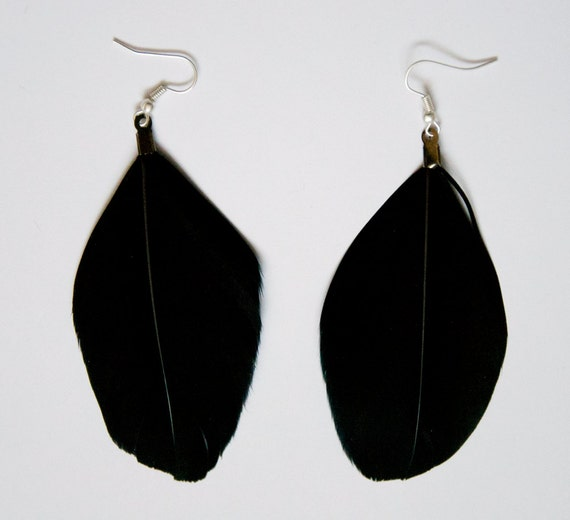 items similar to big black feather earrings on etsy