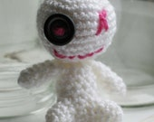 Baby voodoo-style monster (white).