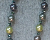 Multicolored shell pearl necklace with alternate AB turquoise crystals and pewter beads.  Magnetic crystal clasp.