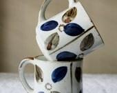 Set of 2 vintage stoneware mugs.