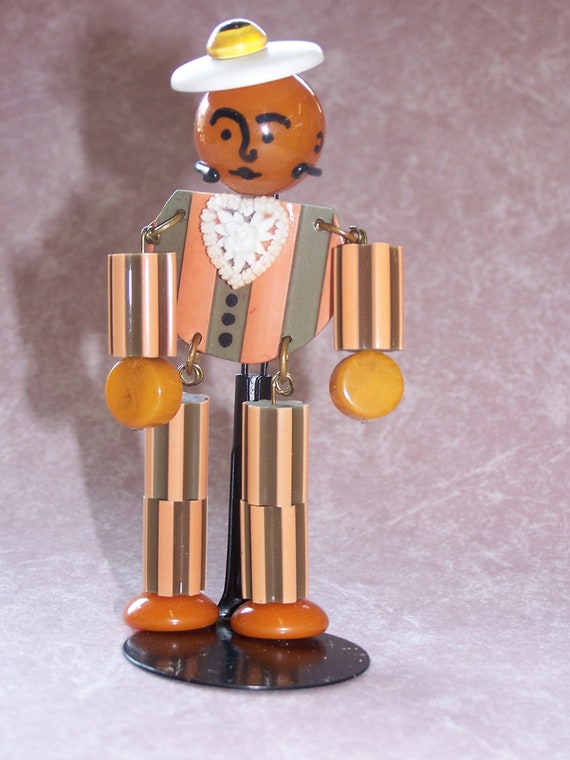 Adorable  Crib Toy Style Bakelite Man