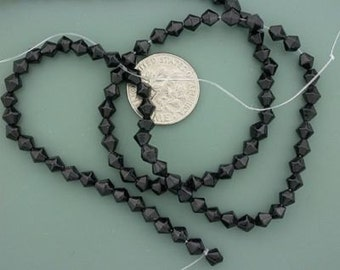 4mm black bicone glass bead strand
