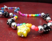 Caged star and black dice rainbow beaded necklace