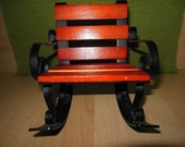Miniature wrought iron and wood rocking chair.