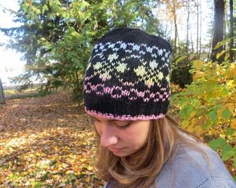 Woman's acrylic/wool machine washable black hat with pastel fair isle pattern