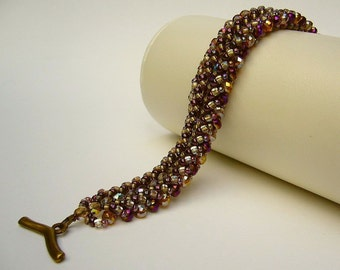 Bracelet with sparkling beads in amber yellow and Violettmetallic