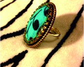 Zandra Adjustable Ankara ring with green diamantes