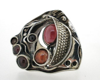 Handcrafted Silver Ring Unique Design by Poran. Garnet and sherry quartz stones. Made In Israel