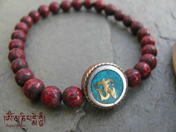 conch shell mantra carved bracelet with om bead