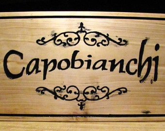 Custom made, hand carved rustic house sign