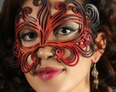 Muse leather mask in orange, red and black