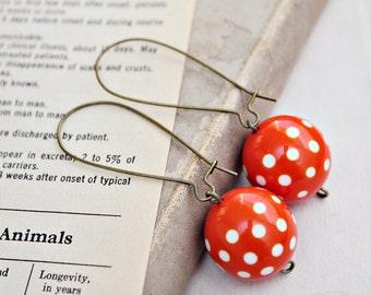 vintage polka dot orange earrings.