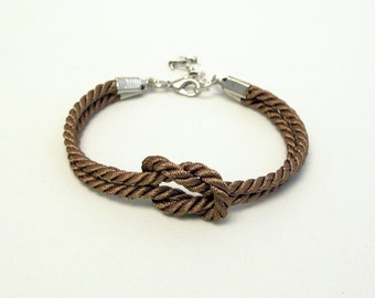 Shiny brown forever knot nautical rope bracelet with silver anchor charm