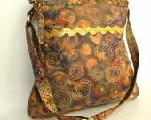 Handmade batik purse. Gold trimmed batik sophisticated hobo shoulder purse with adjustable strap.