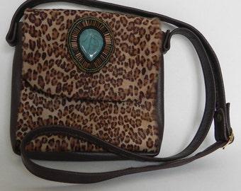 Leopard cowhide evening bag by Opulent Handbags
