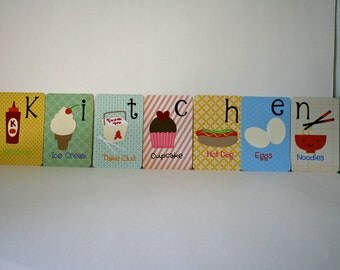 Alphabet cards spelling out KITCHEN.