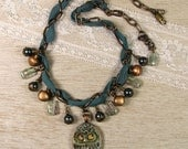 Teal Necklace with Owl Pe...