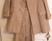 A sweet little  boy probably wore this Garfinckels suit to