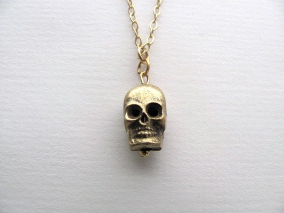 Gold skull charm necklace on delicate 14k gold plate chain, satin finish