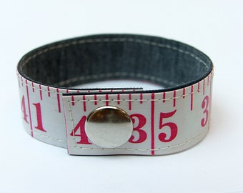 Measuring tape bracelet - White w/ red print (upcycled vinyl)