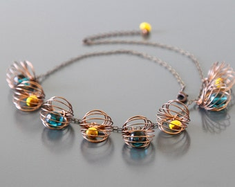 Satellite Dangles Necklace with Vintage Czech Glass Beads and Copper Cages.