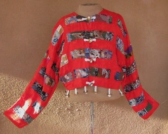 Patchwork crop jacket on red background with coin frogs