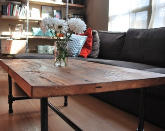 """Wood Coffee table with steel pipe legs made of reclaimed wood, 18"""" tall x 32"""" L x 20"""" w"""