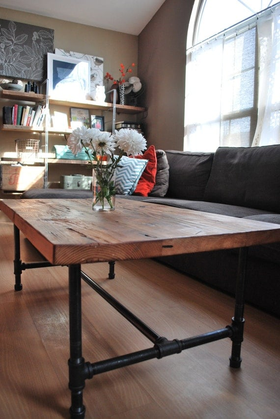 wood coffee table with steel pipe legs made of reclaimed wood. Black Bedroom Furniture Sets. Home Design Ideas