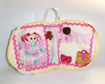 Cloth doll and Dolls house pocket  from travel in miniature