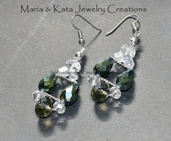 Green Iridescent AB beads w/ smokey grey and white rondelles beads and silver findings