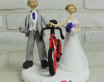 Cycling mania couple with red bike, model airplane wedding cake topper decoration