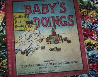 Muslin Child's Book.  1904 Baby's Doings.  1904 Saalfield's Muslin Book.  Y-015