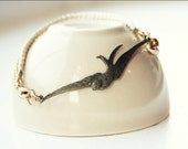 Wings of Love (antique brass swallow and heart bracelet, plaited silk cord and gold chain)