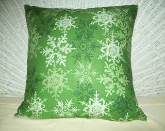 Green and White Snowflake Pattern Pillow