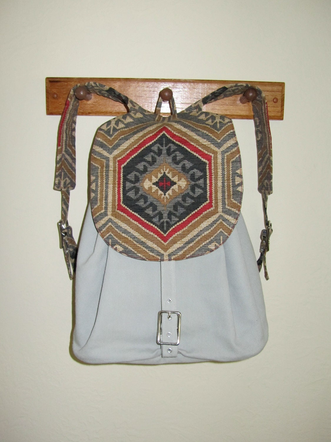 Handmade Backpack with secret compartment by NeedlewinkStitchery