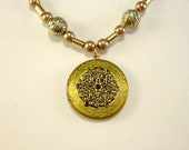 Golden Snowflake Locket Necklace with gold and peach beads