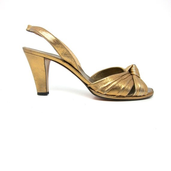 vintage Yves Saint Laurent shoes in gold leather with twisted knot