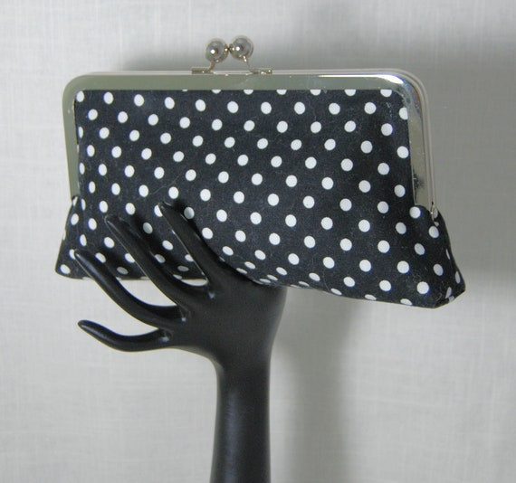 Black with white dots lined with white linen. Perfect size Libby clutch