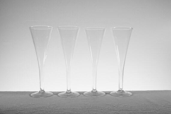 crate barrel trumpet shaped flute champagne glasses set of. Black Bedroom Furniture Sets. Home Design Ideas