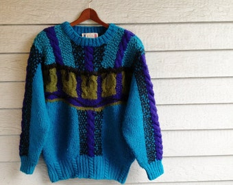 vintage 1980s sweater with fringe. chunky knit in teal, purple & olive green. retro clothing.