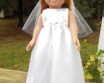 White satin wedding dress with ruffled cape