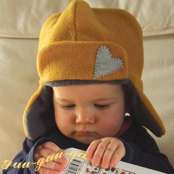 This double lined fleece hat is cute, warm and will work with most of the Halloween Hat packs! Double the warmth of the Original fleece fun hat, this fleece hat with ear flaps pattern comes over the ears to make it perfect for cold weather. Sizes Baby to adult for all to enjoy!