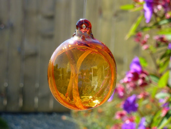 Gold Fumed Striped Amber Glass Ornament